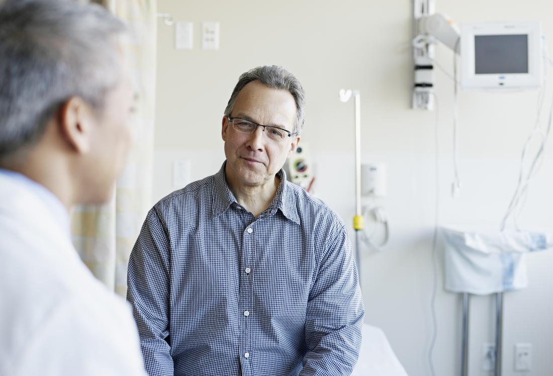 Middle-aged male patient in doctor's office