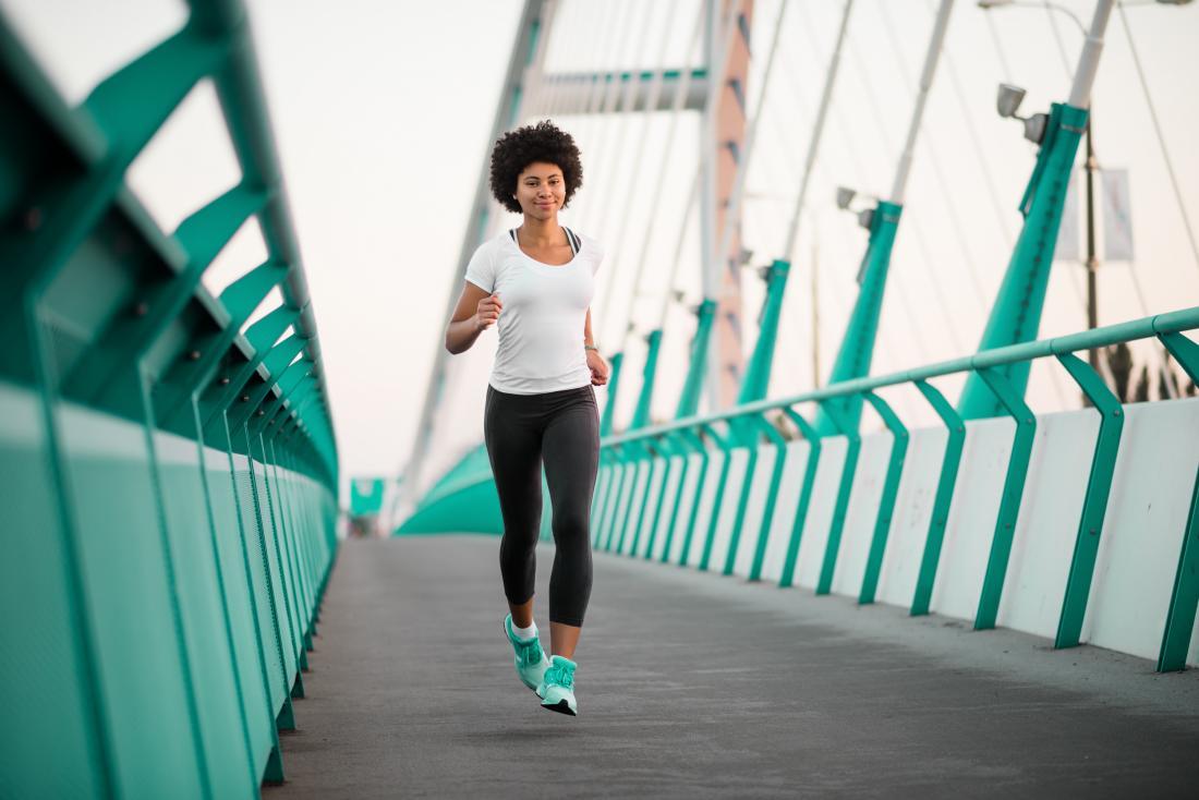 Woman jogging or running on bridge