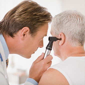 A doctor examines a patient's ear for infection?