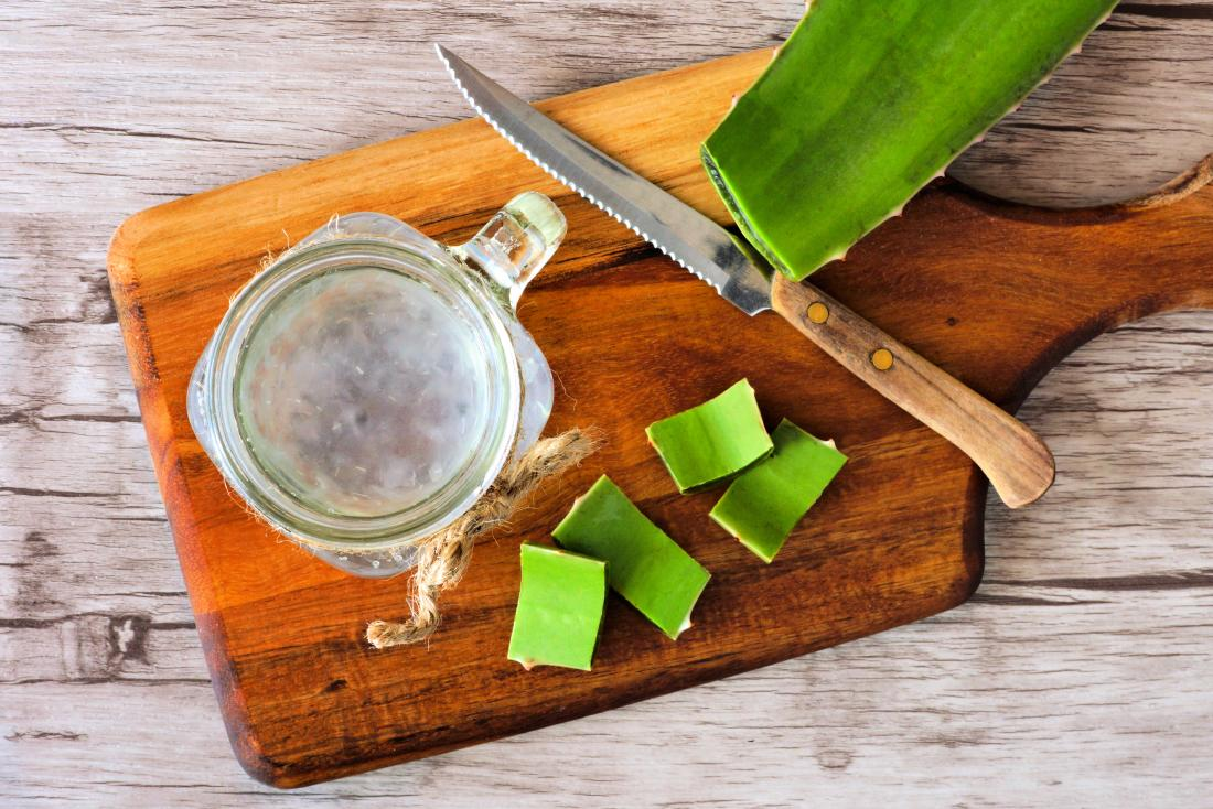 Aloe vera juice in mason jar and chopping board