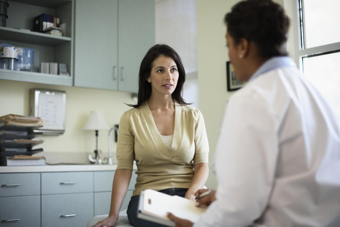 Mature woman in doctor or gynecologists office.