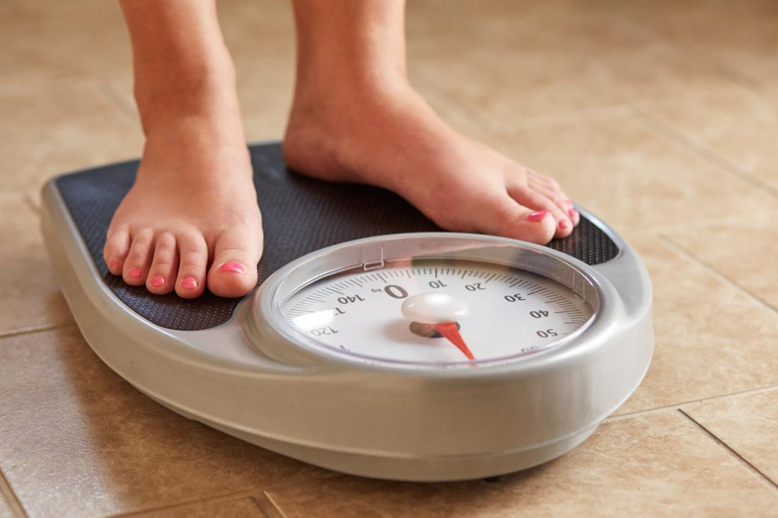 woman standing on scales