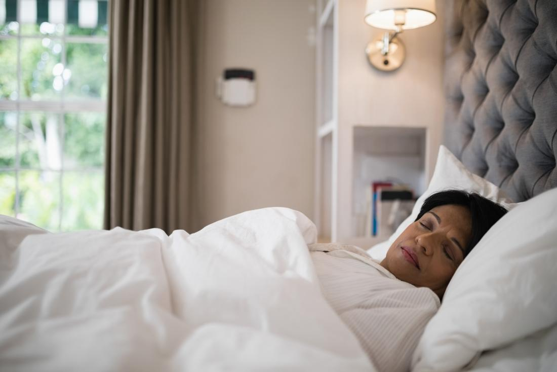 mature lady sleeping in bed