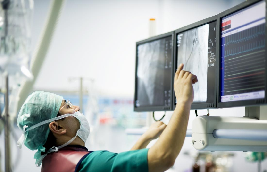 Surgeon looking at screen in operating theatre