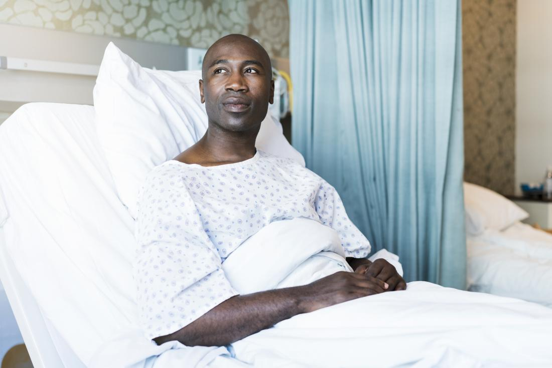 Patient in hospital bed.