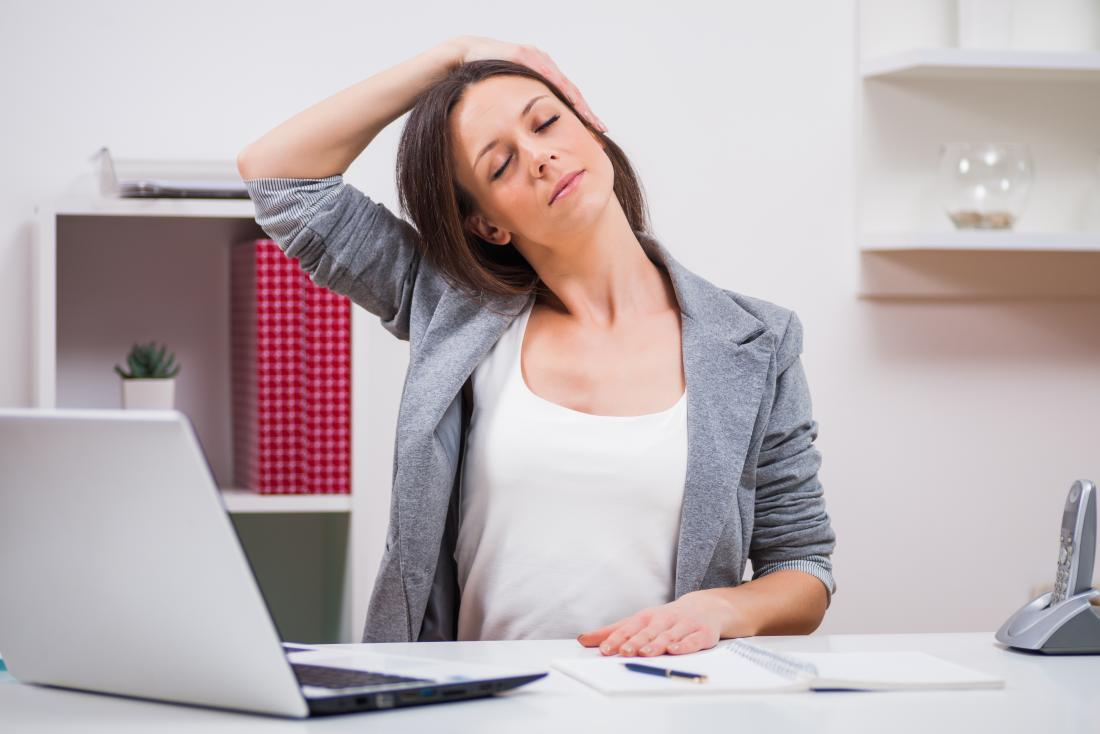 Ear to shoulder neck stretch while sitting in chair at desk