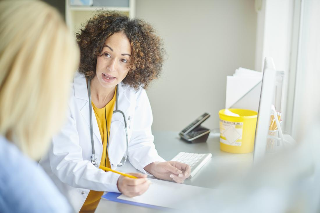 female doctor in office speaking to patient