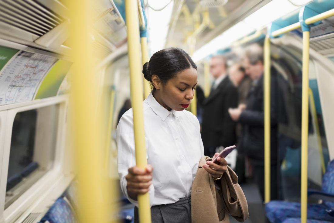 Woman using phone on public transport