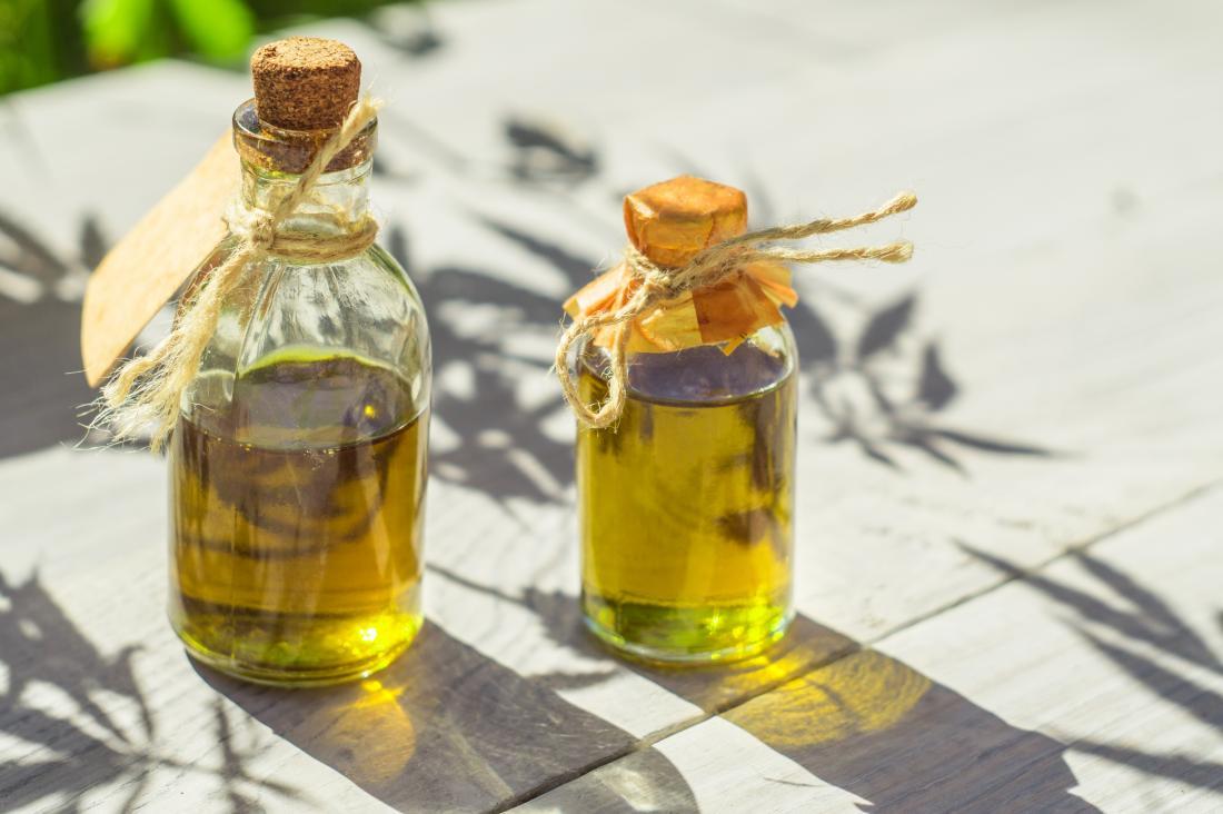 Bottles of oil on wooden table