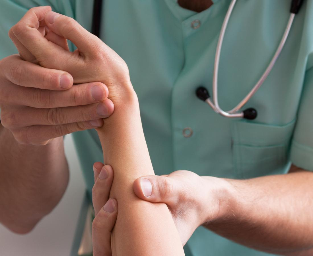 Dermatologist checks woman's arm to identify psoriasis