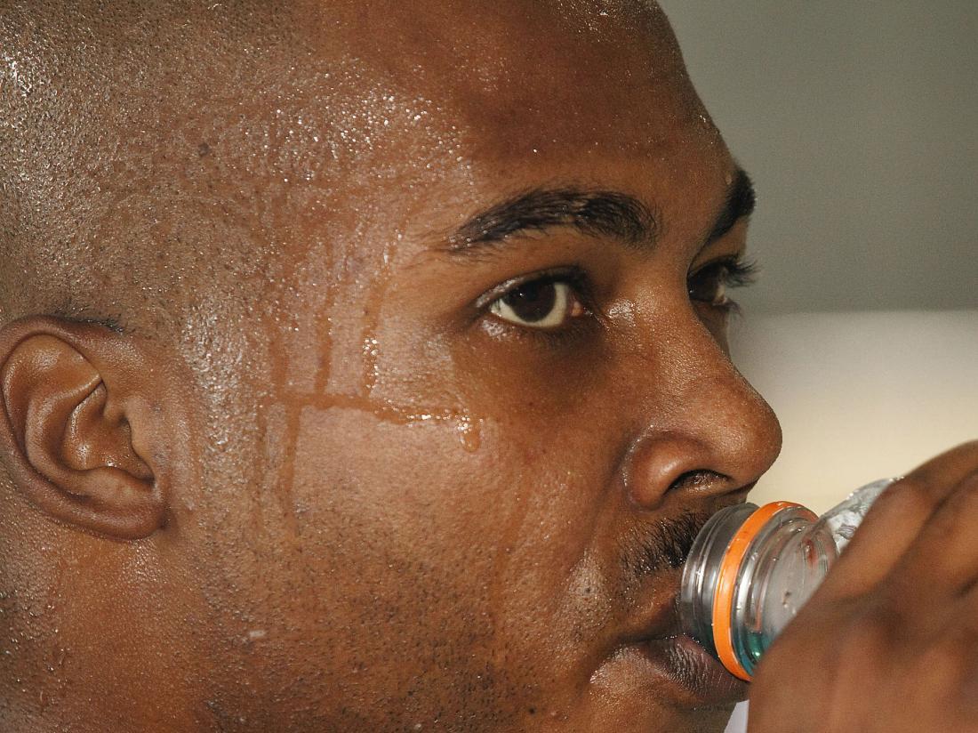 Man sweating due to diaphoresis