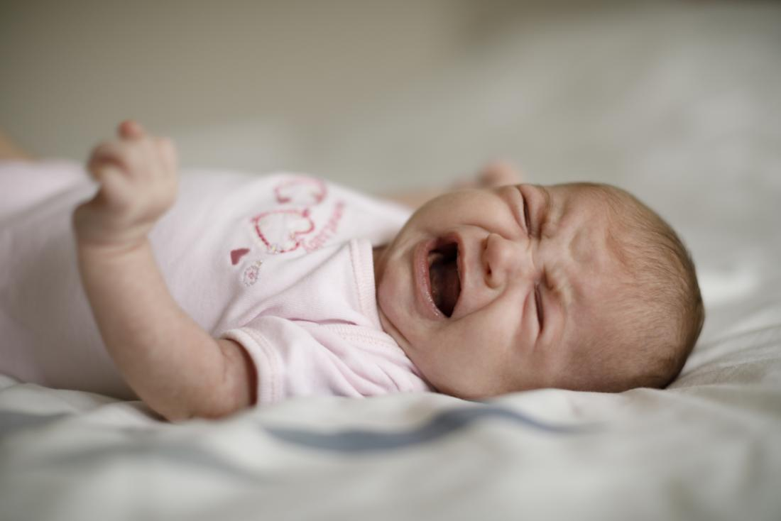 Baby on bed crying