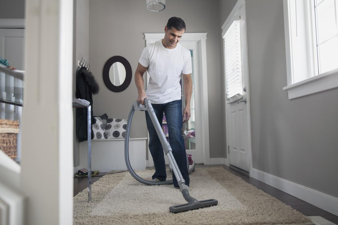 Man vacuuming house with hoover