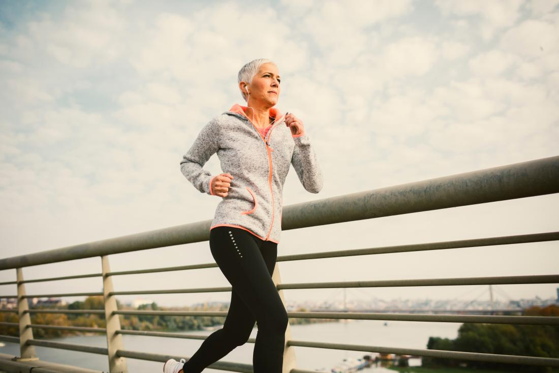 Mature woman with brown discharge after menopause running outside.