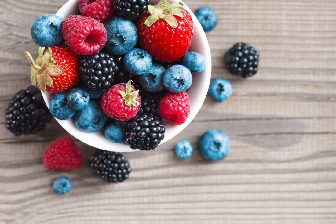 Mixed berries in a bowl including blueberries, blackberries, raspberries, and strawberries