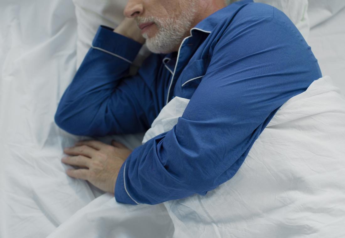 Older man asleep in pajamas
