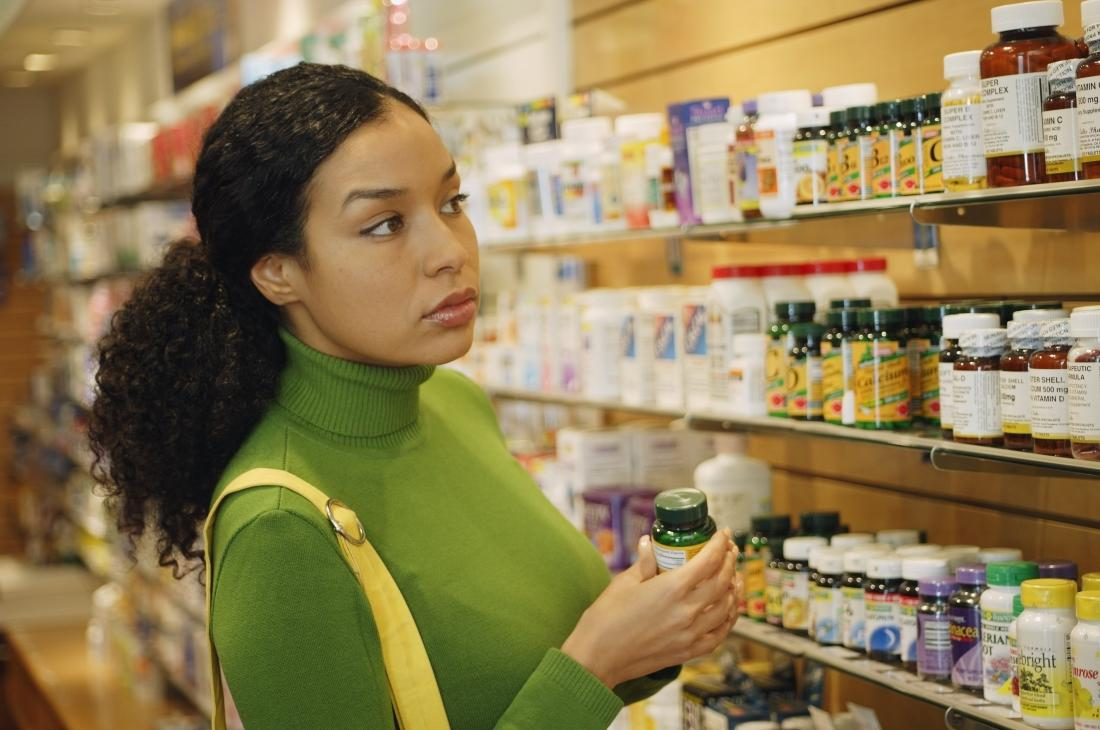 Woman in a store shopping for MSM supplements