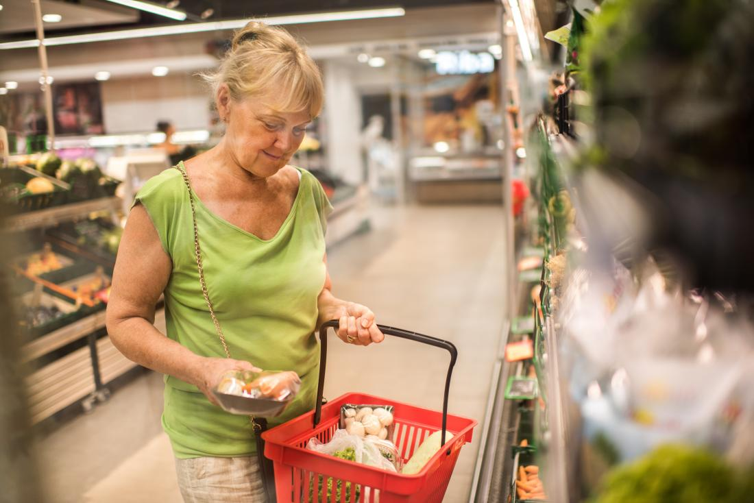 senior woman shopping in supermarket