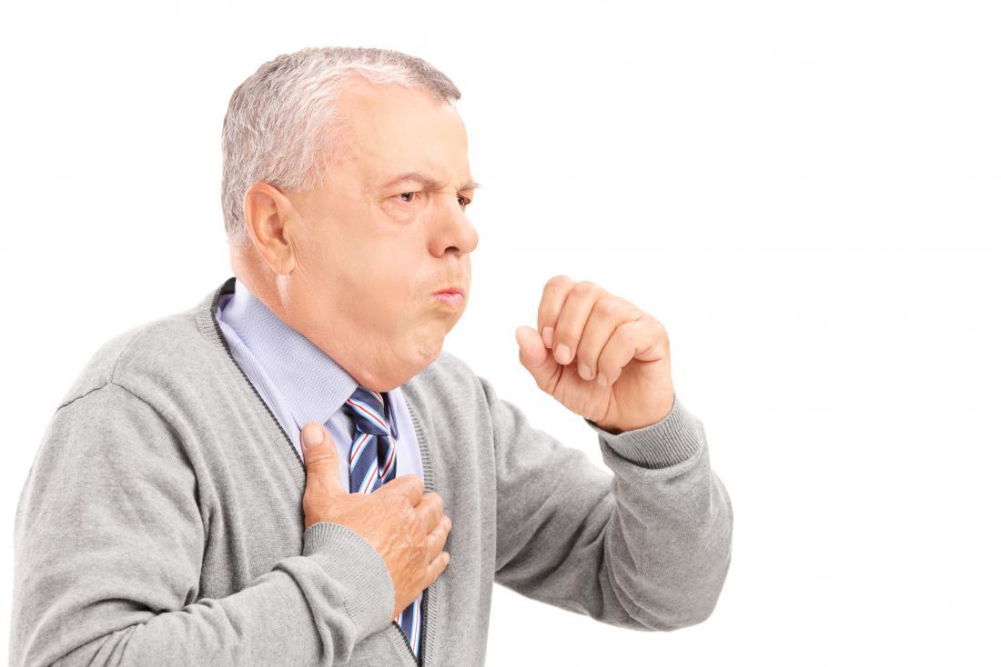 senior man with a cough