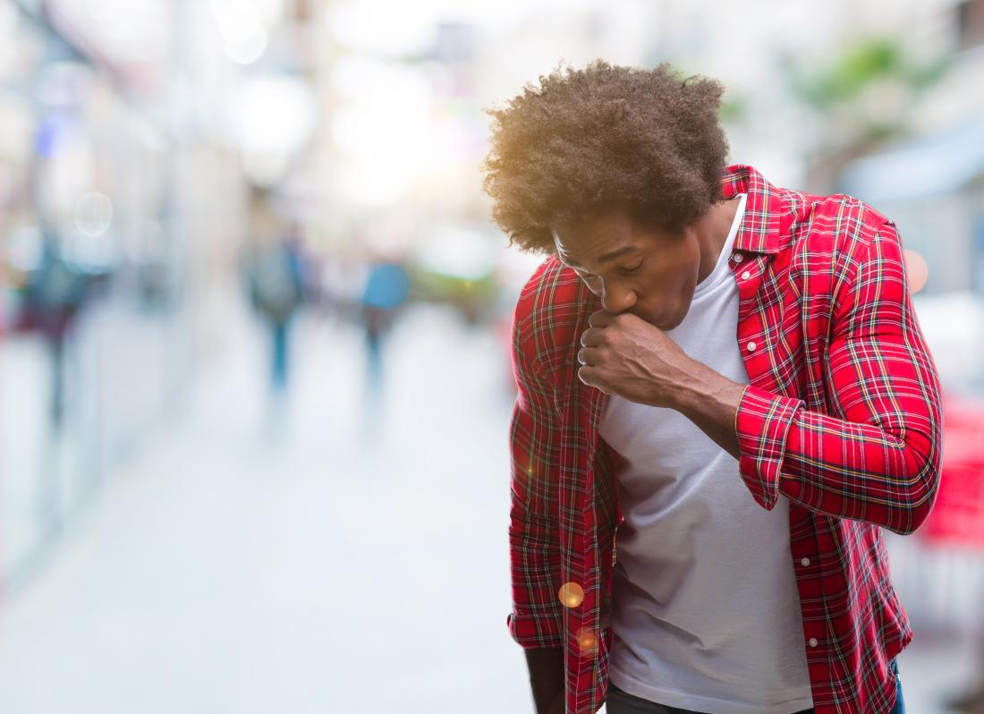 Man coughing which can be a symptom of asthma