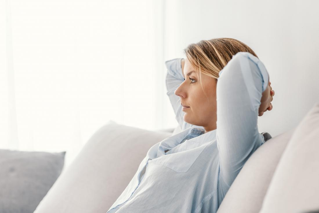 woman sat on her sofa working out her respiratory rate