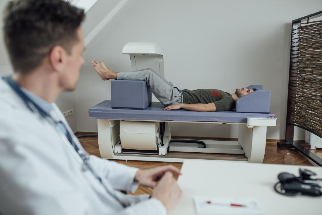 doctor using a dexa scan on a patient