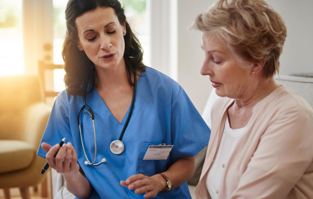 Female doctor discussing issue with senior post-menopausal woman.