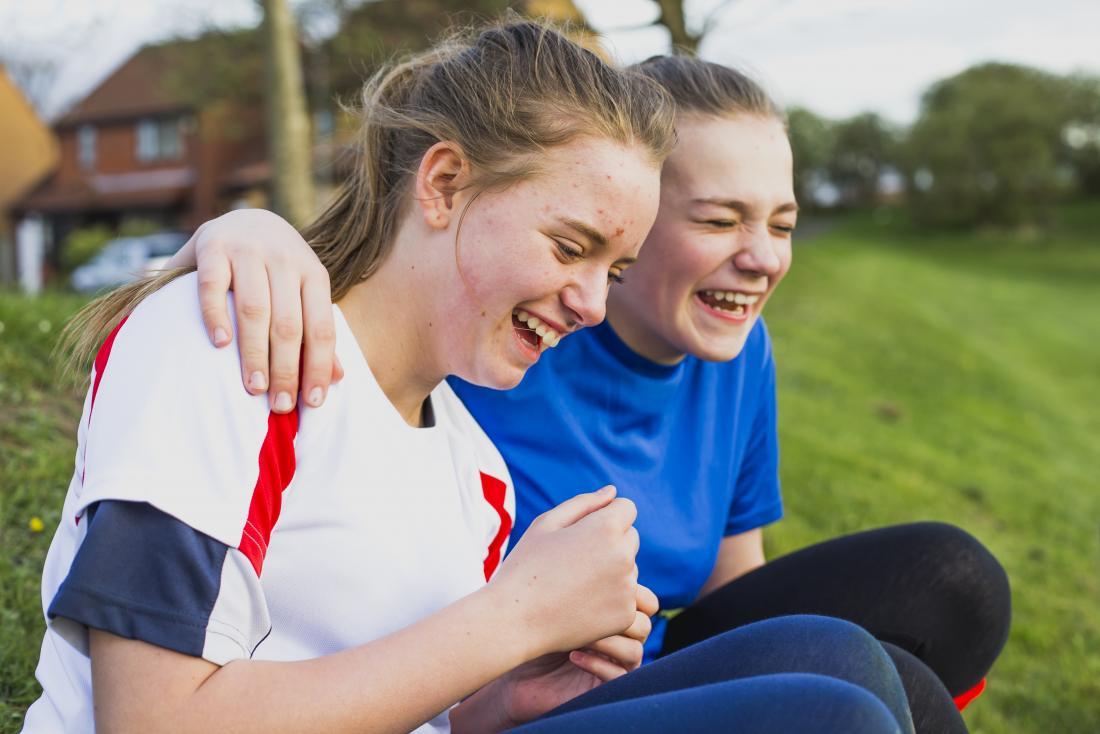 two teenage girls laughing