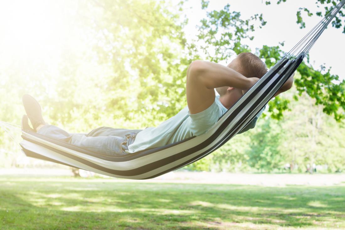 man sleeping in hammock