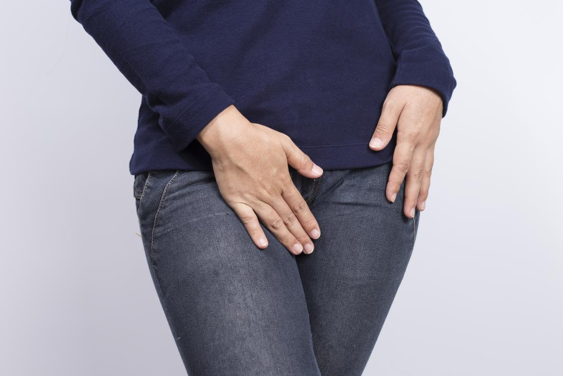 Woman covering crotch with her hands.