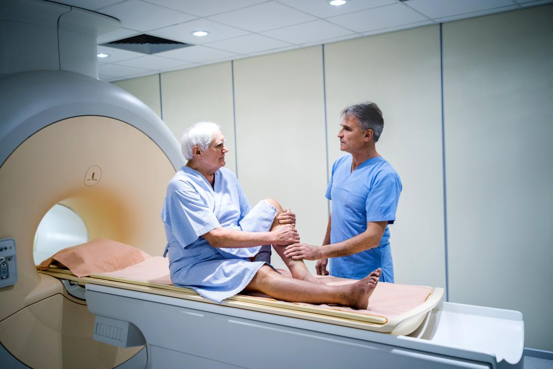 older man about to have mri scan