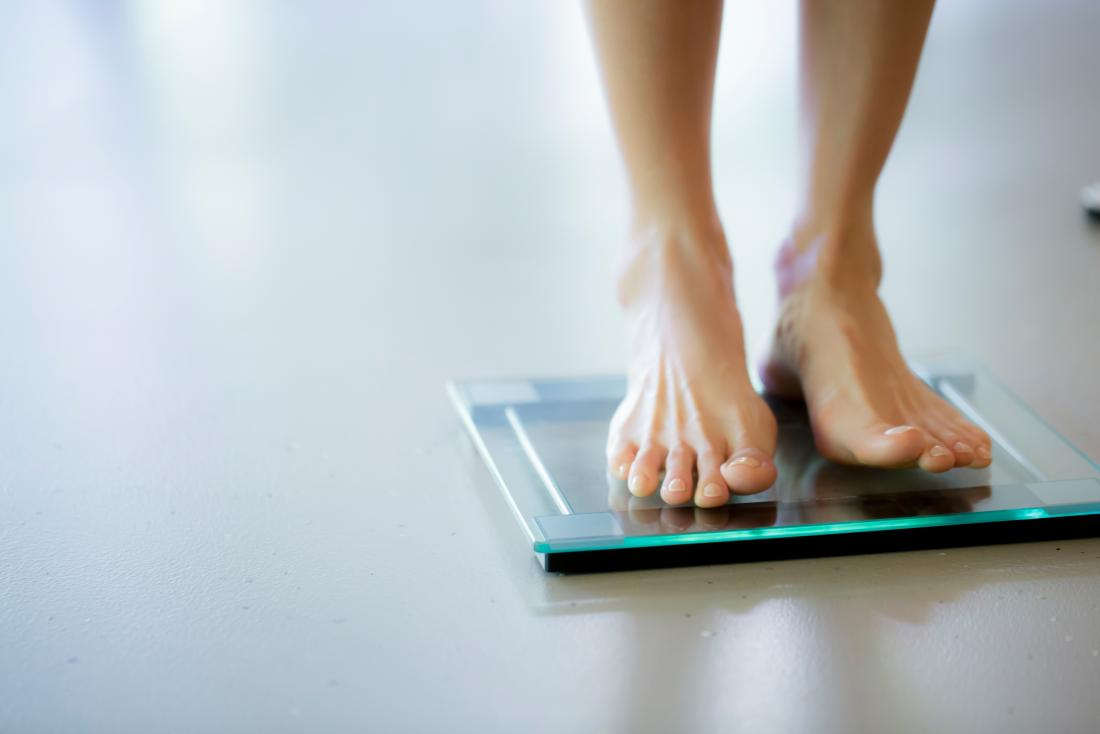 Person on weighing scales