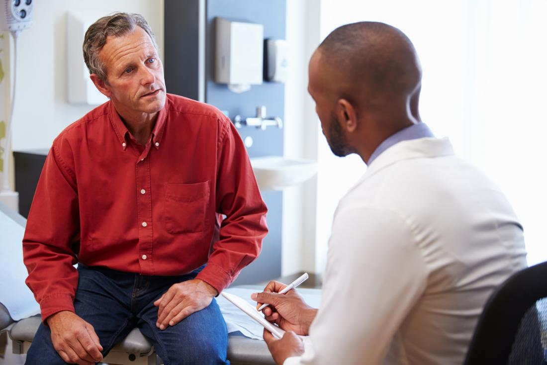 Man discussing Chronic prostatitis with male doctor in office.