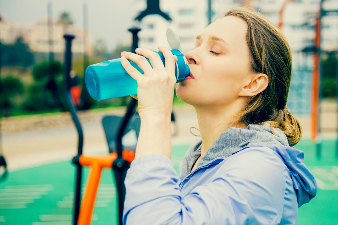 Woman drinking water with electrolytes