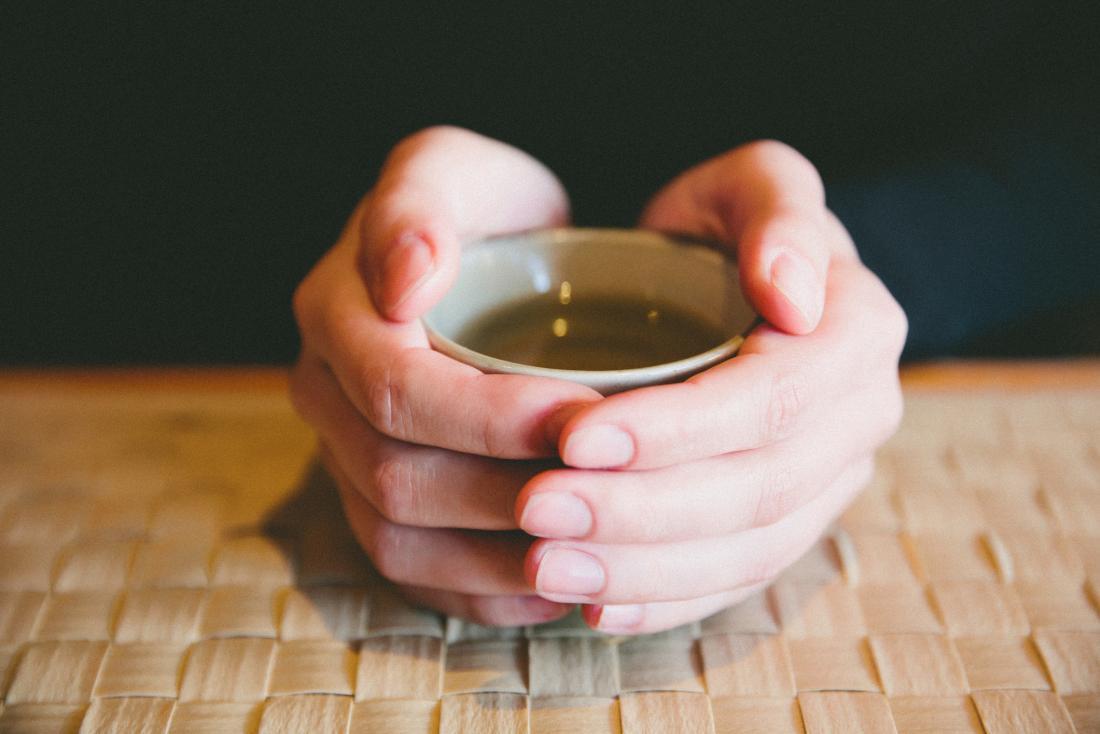 Person drinking green tea