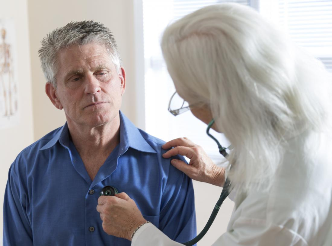 senior man having his heart examined by doctor