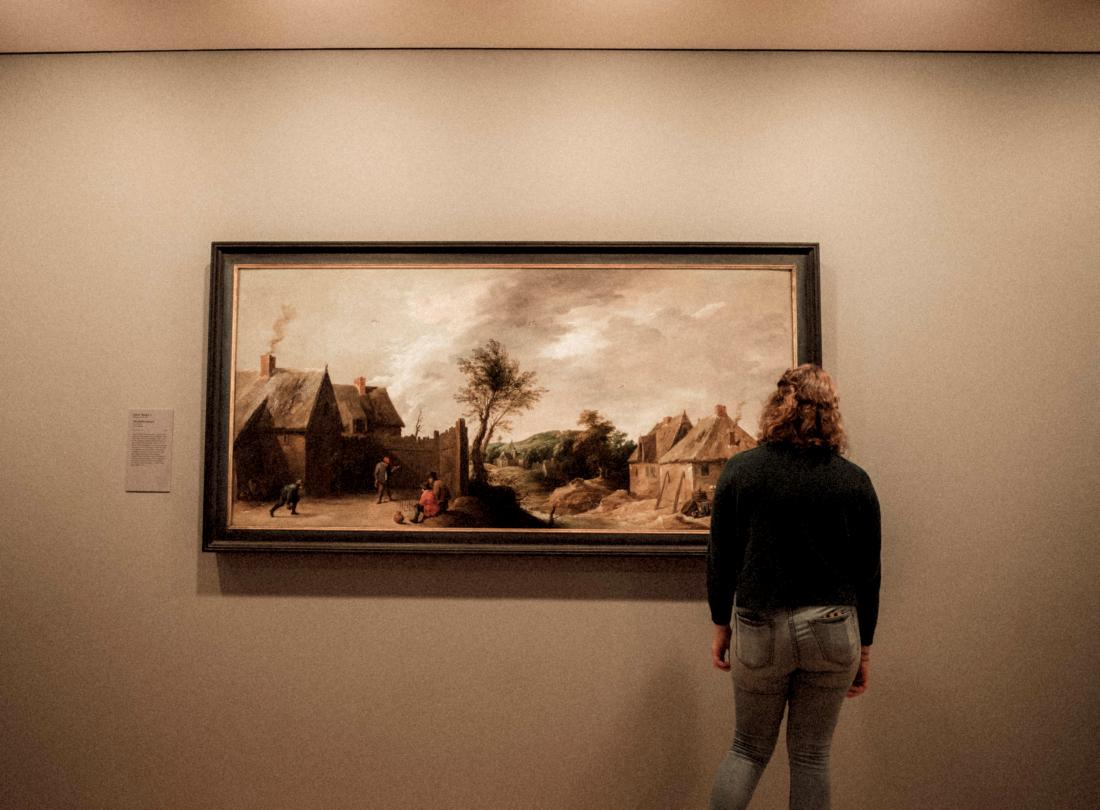 person looking at a painting