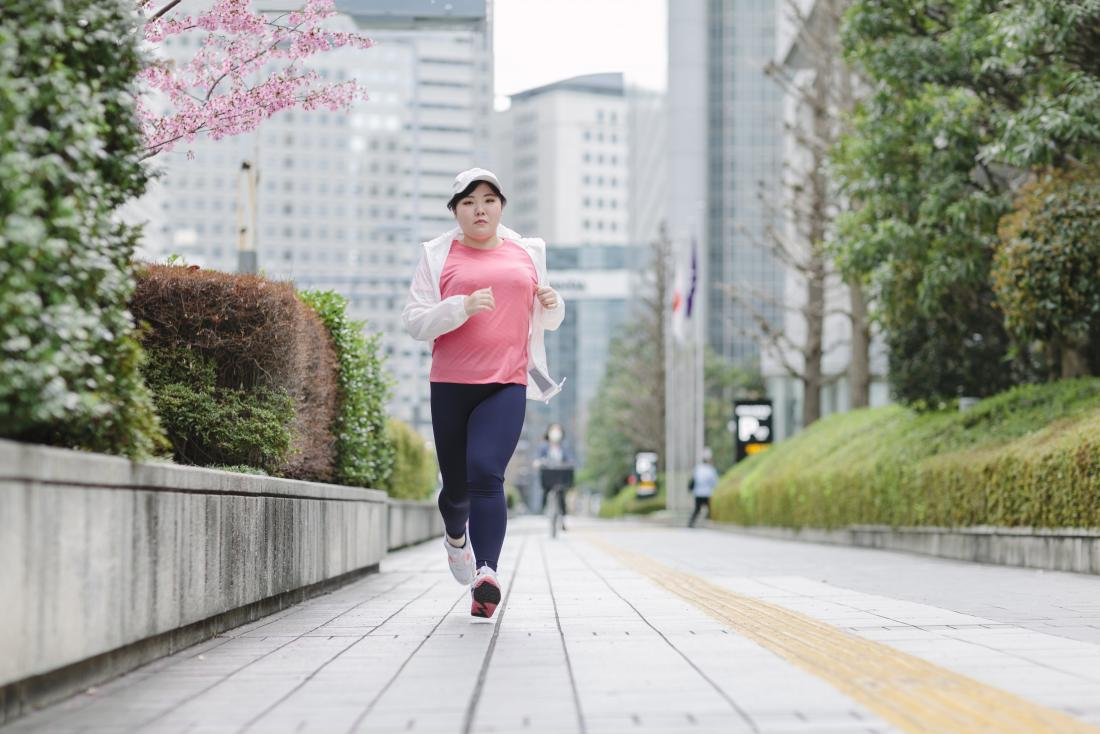 Woman running in a city to get into ketosis fast