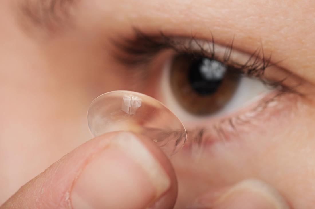close up of contact lens being put in eye