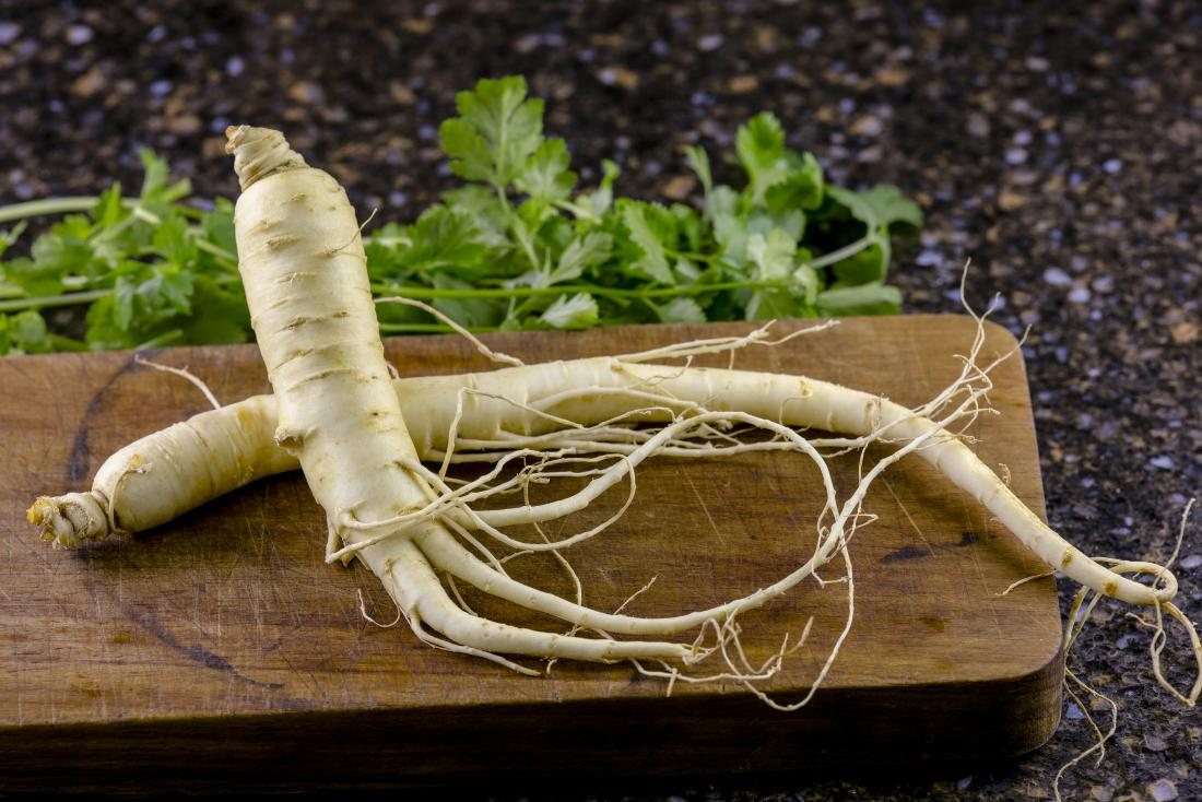 North American Ginseng root on chopping board