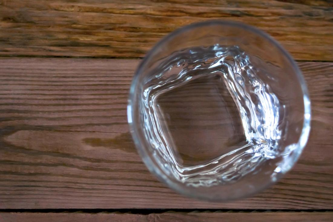Top down view of empty glass on wooden table