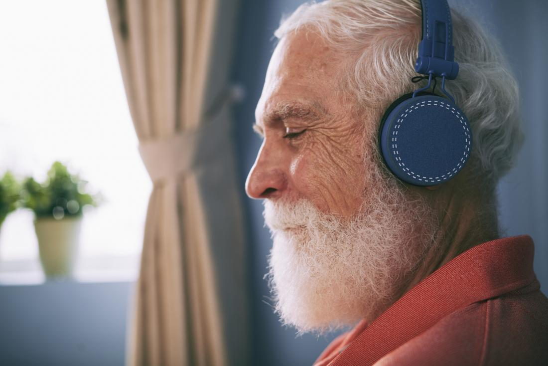 Older adult listening to music