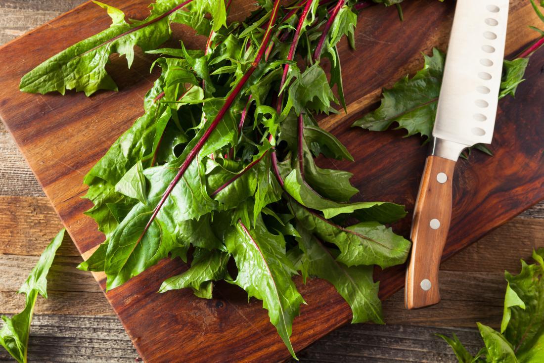 dandelion greens on a chopping board