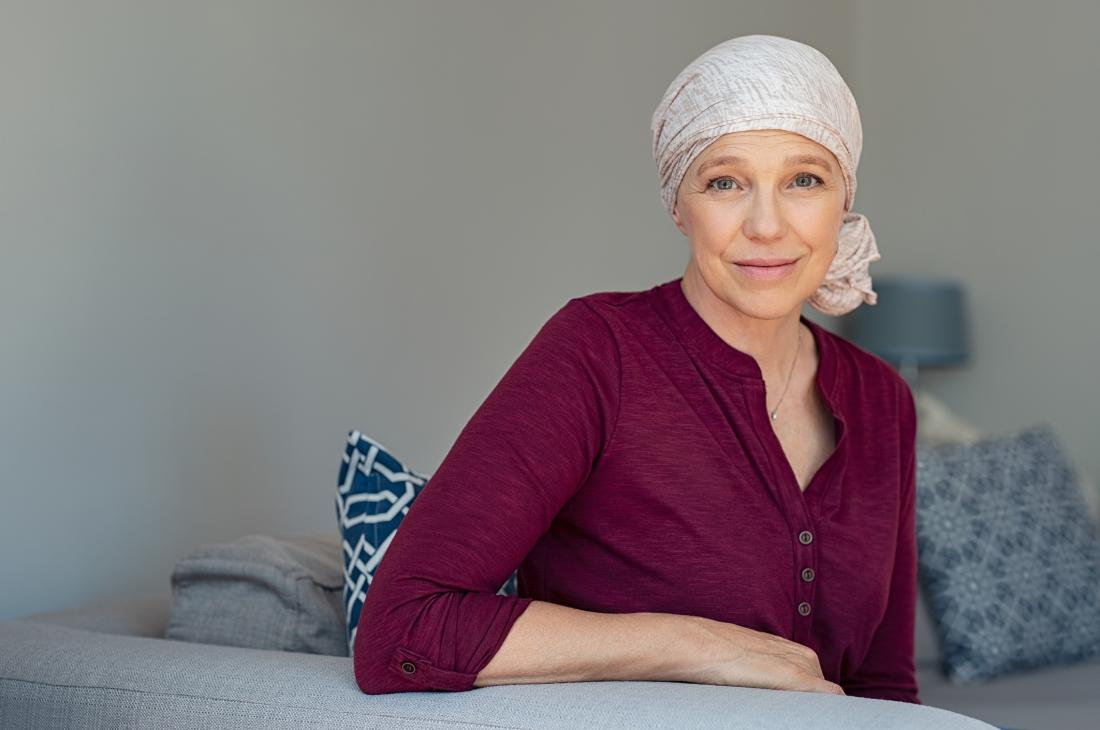 middle aged cancer survivor looking at camera