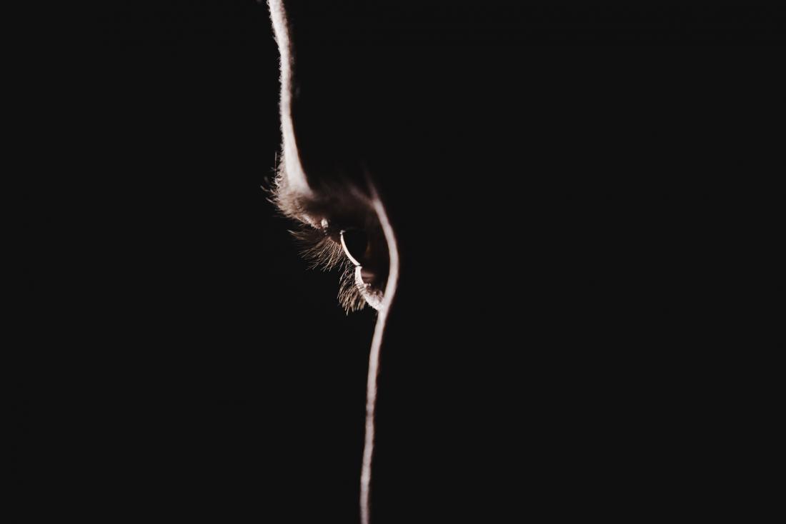Eye close up in dark