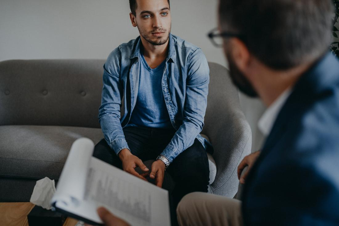 Man having cbt counseling or therapy with psychotherapist