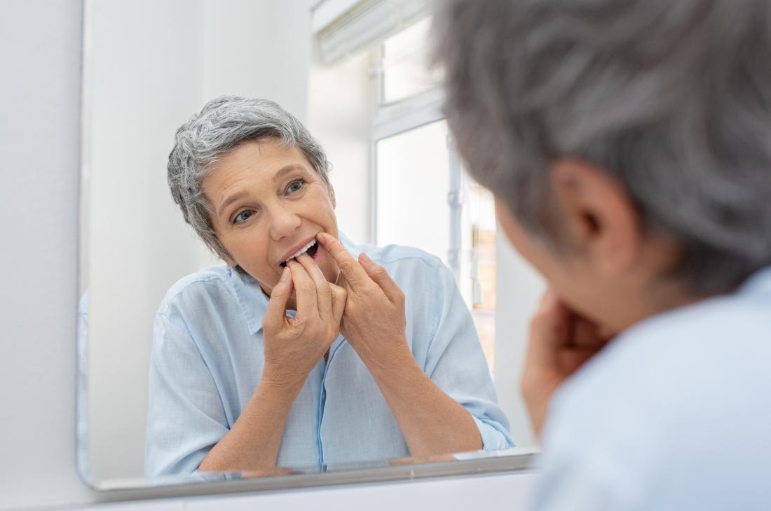 senior woman flossing