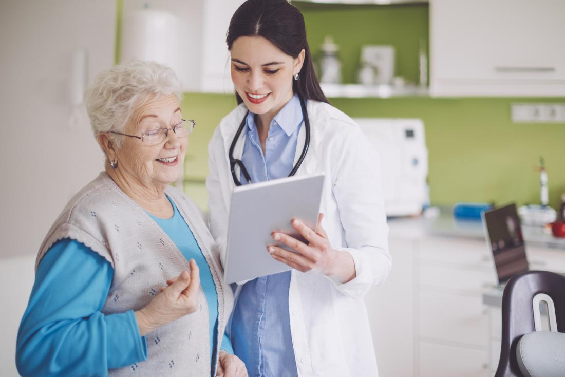 older lady looking at blood pressure results with doctor