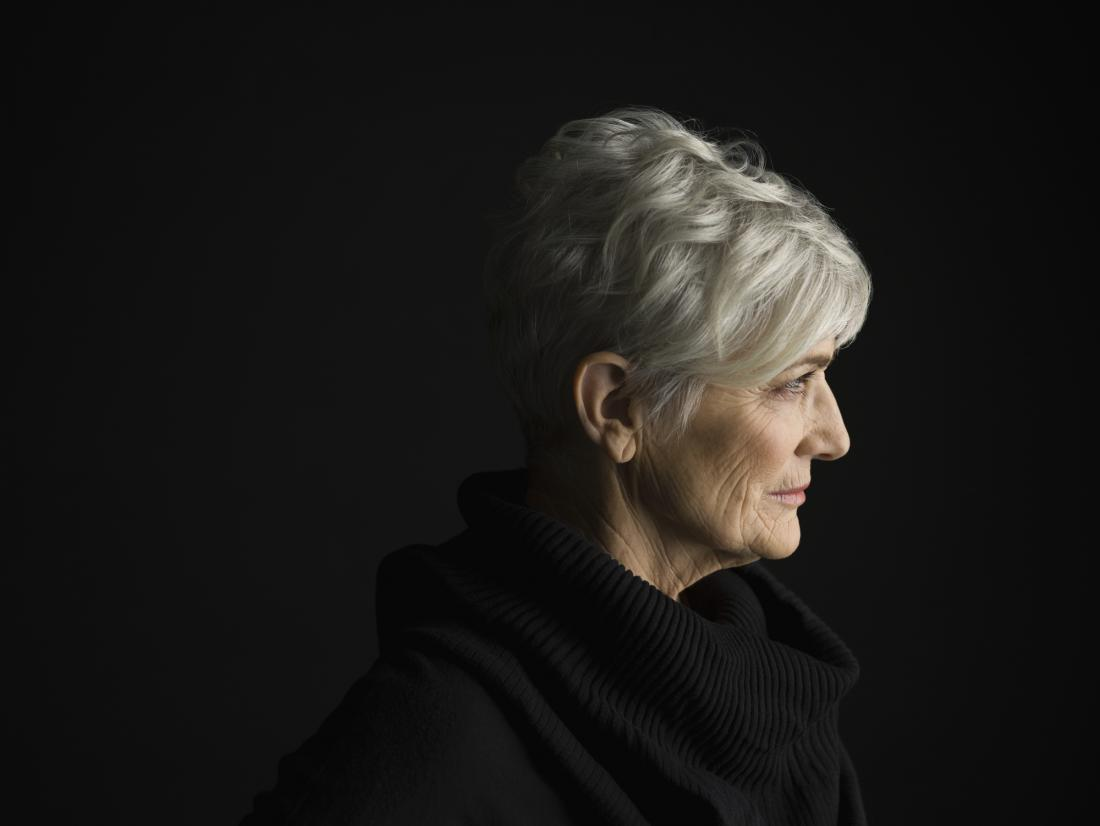 older woman with white hair and a black jumper