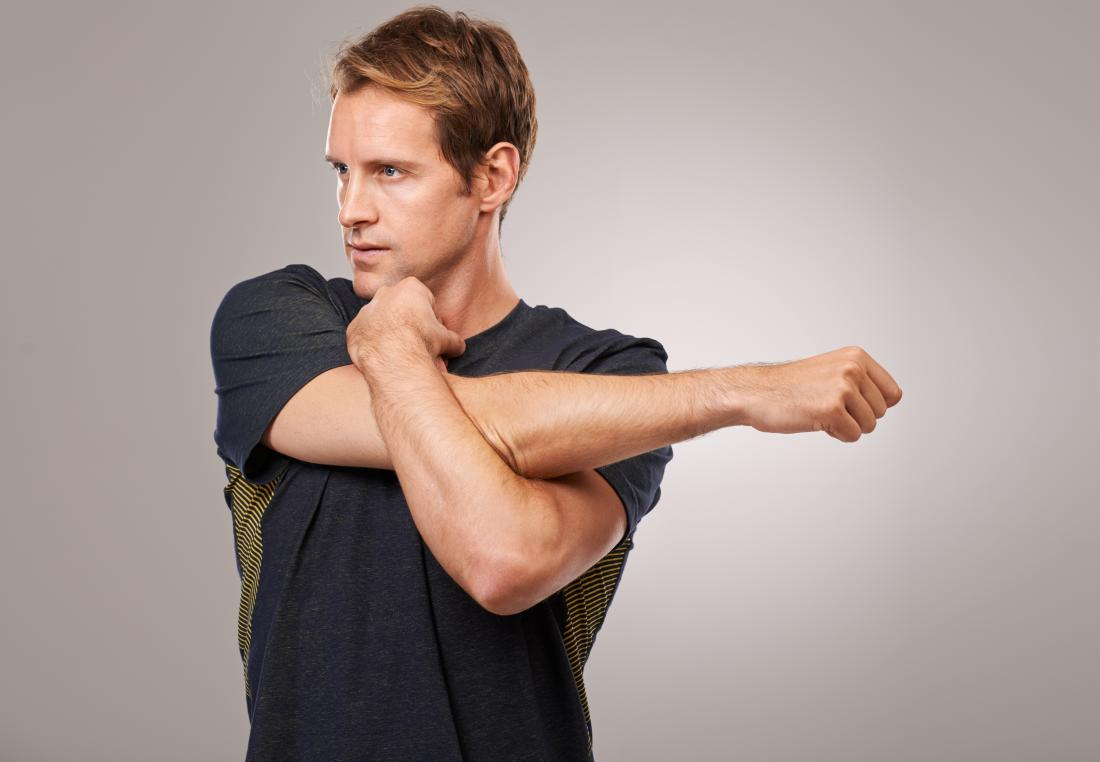 Man doing Cross-body shoulder stretch for arm warmup